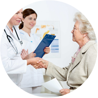 Doctor and nurse discussing medicare with elderly woman